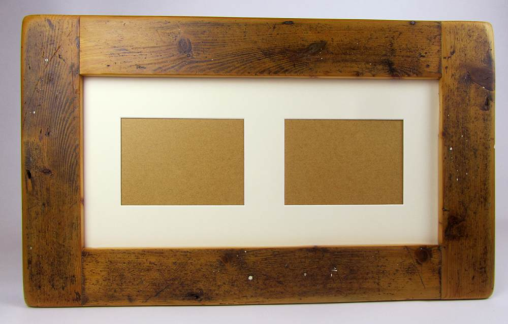 Picture frame with two holes cut into the mount