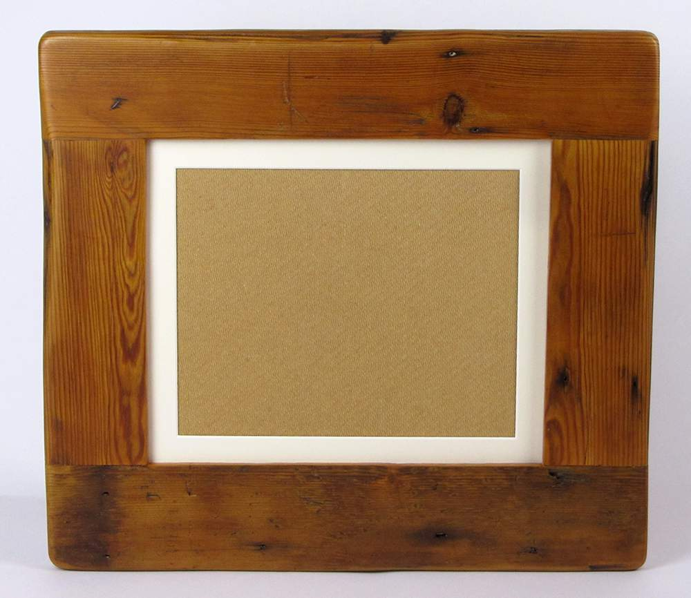 Picture frame with one hole cut into the mount